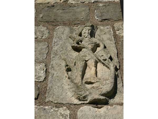 Carving of St Michael & The Dragon